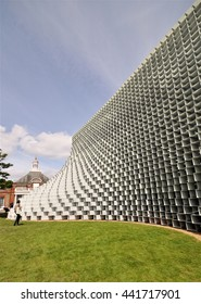 LONDON - JUNE 8, 2016. The Serpentine Gallery summer pavilion is designed by Danish architects BIG (Bjarke Ingels Group) with a structure of hollow fibreglass blocks in Kensington Gardens, London, UK.