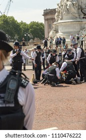 London. June 9 2018. A view of policemen and women attending to  former  army chief Lord Guthrie who fell off his horse during the Queens birthda - Trooping the Colour.