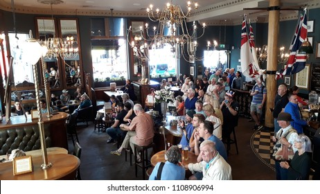 LONDON - JUNE 9: Interior of pub, for drinking and socializing, focal point of the community, on June 9, 2018, London, UK. Pub business, now about 53,500 pubs in UK, has been declining every year.