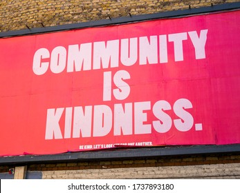 """London lockdown, 21st May, 2020. East London, UK. """"Community is kindness"""". Advertising billboard campaign poster to boost morale of Londoners during lockdown. Covid-19 pandemic. Coronavirus."""