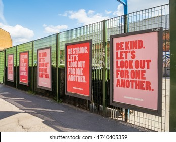 """London lockdown, Brick Lane, UK. 24th May, 2020: """"Be kind, let's look out for one another"""". Advertising billboard campaign poster to boost morale of UK people during lockdown. Covid-19 pandemic."""