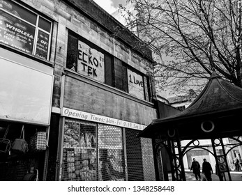 London Luton, United Kingdom - 24 March 2019: Black and white classic style photos of Luton Town centre George street near Luton Town hall  and shopping mall and Debenhams building.