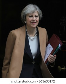 LONDON - MAR 15, 2017: Prime Minister Theresa May seen leaving 10 Downing Street to attend Prime Minister's Question Time in House of Commons.