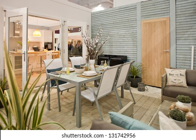 LONDON - MAR 15: a furnished garden setting at the Ideal Home Show 2013 in London on March 15, 2013. It is the annual event that brings together the latest inventions and designs for the modern house.