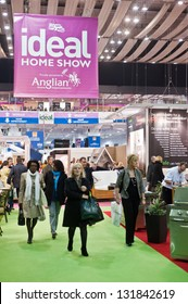 LONDON - MAR 15: visitors walk past exhibitor stands during the Ideal Home Show 2013, held at Earl's Court in London on March 15, 2013.