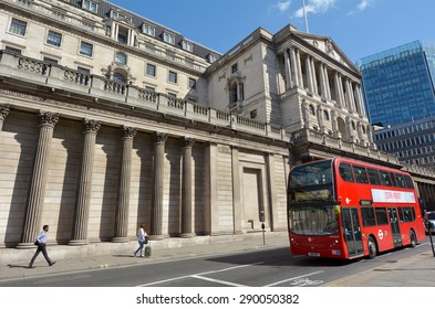 LONDON - MAR 18 2015:People and traffic pass by Bank of England Headquarters in City of London, UK.The Bank is custodian to the official gold reserves of the United Kingdom and many other countries.