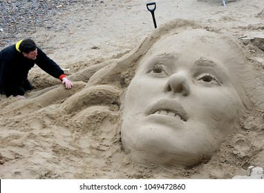 LONDON - MARCH 10, 2018. A sand sculpture at low tide along the south bank of the River Thames in central London, UK