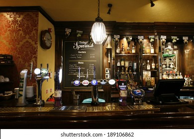 LONDON - MARCH 14: Interior of pub, for drinking and socializing, focal point of community, on March 14, 2014, London, UK. Pub business, now about 53,500 pubs in the UK, has been declining every year