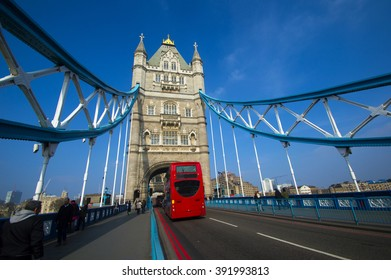 LONDON - MARCH 18, 2015 : Pedestrians and vehicles pass on the Tower Bridge in London, UK.The Tower Bridge is crossed by over 40,000 people (motorists, cyclists and pedestrians) every day.