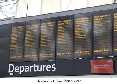 London, March 2017 - A departure board listing train services from London's Waterloo railway station