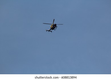 London, March 2017. A helicopter carrying the markings of London's Metropolitan Police, equipped with cameras and operated by the United Kingdom's National Police Air Service, flies above Westminster