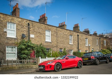 LONDON- MARCH, 2018: An attractive residential street and sports cars in Wandsworth
