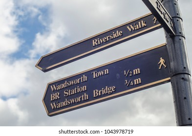 London- March 2018: A directional sign post in Wandsworth, south west London close to Wandsworth Bridge and Wandsworth Town station