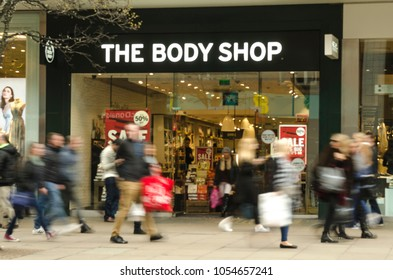 LONDON- MARCH, 2018: Exterior of The Body Shop store on Oxford Street, London with crowds of motion blurred shoppers passing by