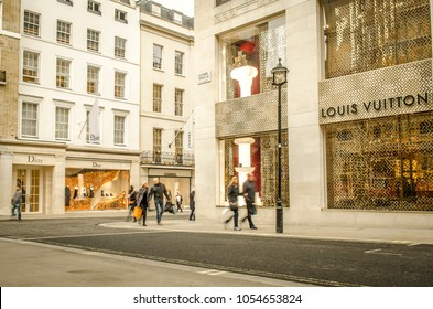 LONDON- MARCH, 2018: Exterior of Louis Vuitton and Dior high end fashion shops on New Bond Street in London's upmarket district of Mayfair.