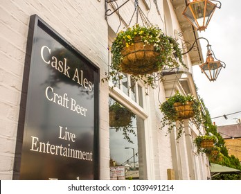 LONDON- MARCH, 2018: Exterior of a traditional village style pub in Wimbledon Village with sign advertising craft ales and cask beers