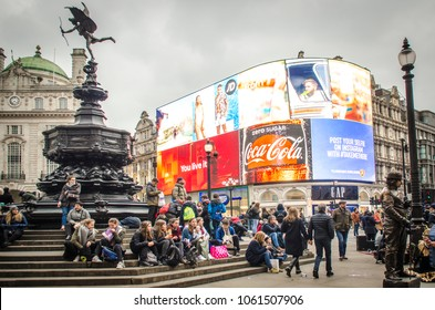 LONDON- MARCH, 2018:  Piccadilly Circus fountain and giant new advertising screen, a famous London landmark and busy destination for shoppers and tourists
