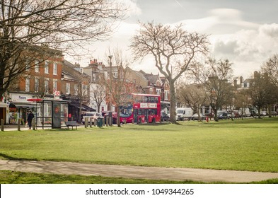 LONDON- MARCH, 2018: View of Bellevue Road from Wandsworth Common. A large open space recreation area next to attractive high street shops, restaurants and cafes in south west London