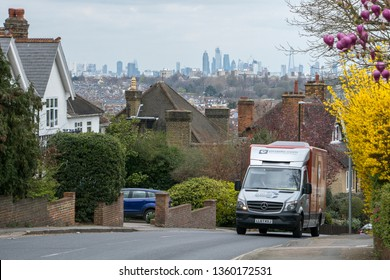 LONDON- MARCH, 2019: An Ocado delivery truck in a residential area of Wimbledon in South West London