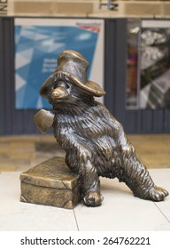 LONDON - MARCH 22, 2015:Paddington Bear life-sized bronze statue stands at Paddington Station in London honoring the Paddington Bear literary character. It is designed by the sculpture Marcus Cornish