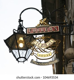 LONDON - MARCH 25: English pub sign, Public house, known as pub, is focal point of community, on March 25, 2012, London, UK. Pub business, now about 53,500 pubs in UK, has been declining every year