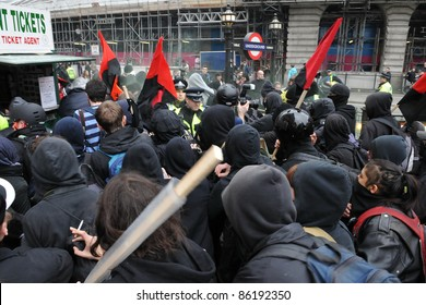 LONDON - MARCH 26: Anti-cuts protesters push through police lines on Picaddilly during a large anti-cuts rally on March 26, 2011 in London, UK.
