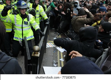 LONDON - MARCH 26: A breakaway group of protesters clash with police on Piccadilly Street during a large anti-public sectors spending cuts rally organized by the TUC on March 26, 2011 in London, UK.