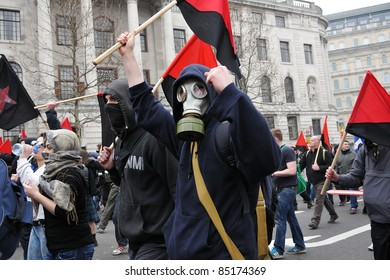 LONDON - MARCH 26: A breakaway group of anarchist protesters march through the streets of the British capital during a large anti-cuts rally March 26, 2011 in London, UK.