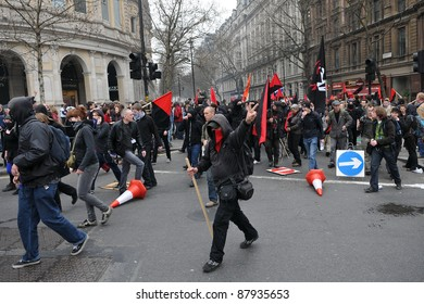 LONDON - MARCH 26: A breakaway group of anarchist protesters march through the streets of the British capital during a large TUC organised anti-cuts rally on March 26, 2011 in London, UK.
