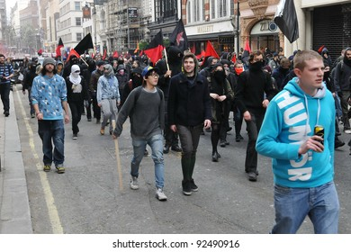 LONDON - MARCH 26: A breakaway group of protesters march through the streets of the British capital during a large austerity rally on 26 March 2011 in London, UK.