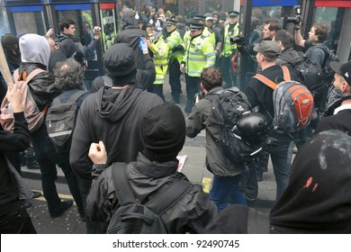 LONDON - MARCH 26: A group of breakaway protesters clash with police during a large austerity protest on March 26, 2011 in London, UK.
