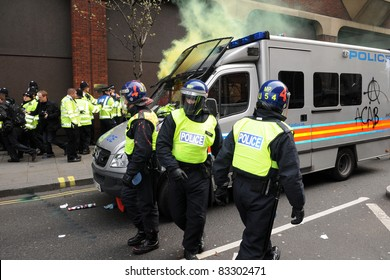 LONDON - MARCH 26: Riot police come under attack during a large anti-cuts rally on March 26, 2011 in London, UK.