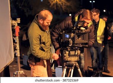 LONDON - MARCH 30, 2012: Film Crew On Location Night Shoot. 4K Camera & Cinematographer. Filmmaking.