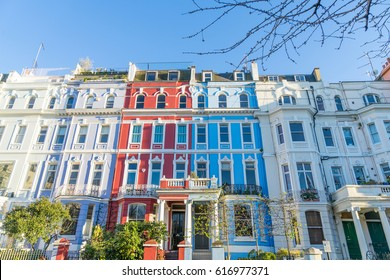 London - March 30: A row of colorful town houses in London Notting Hill on March 30, 2017.