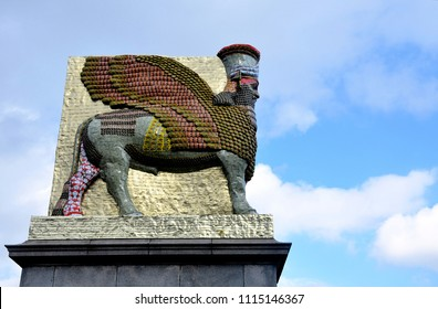 LONDON - MARCH 31, 2018. A statue of empty Iraqi date syrup cans by Michael Rakowitz re-creates the 2700 year old Lamassu, a diety destroyed in Nineveh, on the Fourth Plinth, Trafalgar Square, London.