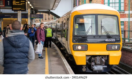 LONDON - MARCH 9, 2016:  London Bridge Station, Train Arriving With People Waiting To Board.