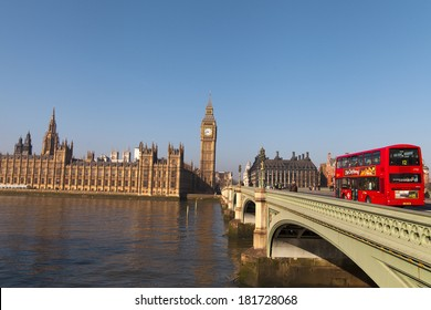 LONDON -  MARCH 9. Iconic London bus crossing Westminster Bridge in the United Kingdom March 9, 2014 in London, England.