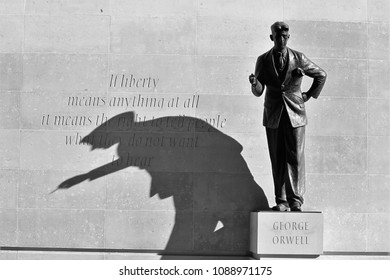 LONDON - MAY 06, 2018: ( Image digitally altered to monochrome ) George Orwell statue casting a shadow in the bright sun outside BBC buildings