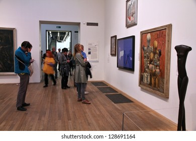 LONDON - MAY 14: People visit Tate Modern gallery on May 14, 2012 in London. It is the most-visited modern art gallery worldwide, with around 4.7 million visitors per year.