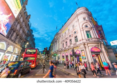 LONDON - MAY 15, 2015: Tourists and locals around Piccadilly Circus at sunset. This place is of the major tourist attractions.