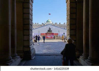 LONDON - MAY 16, 2019: Photo London, photography art fair at Somerset House with visitors in a sunny day in London, England.
