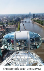 LONDON - MAY 18: Passenger capsule of the London Eye with unidentified people on May 18, 2014 in London. Its currently Europes tallest Ferris wheel and most popular paid tourist attraction in the UK