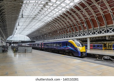 LONDON - May 18: A train pulls into Paddington station on May 18, 2013 in London, UK. Paddington station is one of the busiest in Europe with more than 100 trains per hour during peak times.