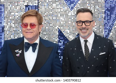 LONDON - MAY 20, 2019: Sir Elton John and David Furnish attends the Rocketman film premiere