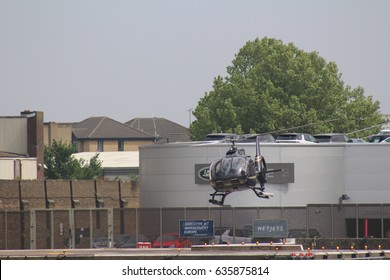 London, May 2017. A black and gold Eurocopter EC130 helicopter used for sightseeing tours takes off from a South West London heliport