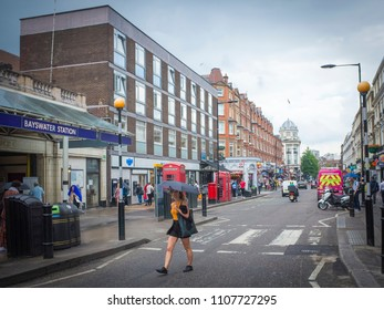 LONDON- MAY, 2018: Bayswater underground station on Queensway. A vibrant road of shops and restaurants in the borough of Kensington & Chelsea