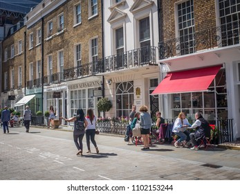 LONDON- MAY, 2018: Motcomb Street in Knightsbridge, an upmarket pedestrianised high street of fashion shops, cafes and restaurants