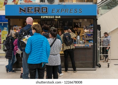LONDON - MAY, 2018: People queue in front of Caffe Nero inside Victoria Station.
