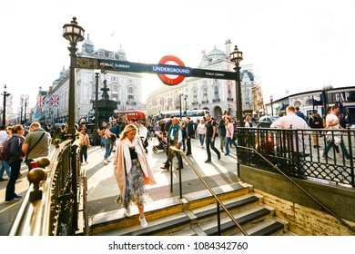 LONDON- MAY, 2018:  Piccadilly Circus and Underground Station scene with overexposed sky. A famous London landmark in London's West End