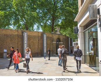 LONDON- MAY, 2018: Shoppers walking on Duke Of York Square by Kings Road, Chelsea- an upmarket shopping area next to Saatchi Gallery
